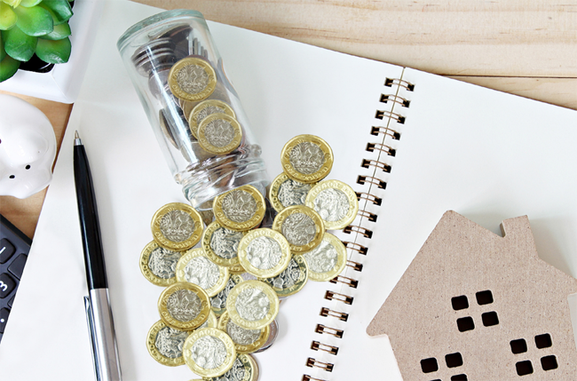 pound coins on writing pad