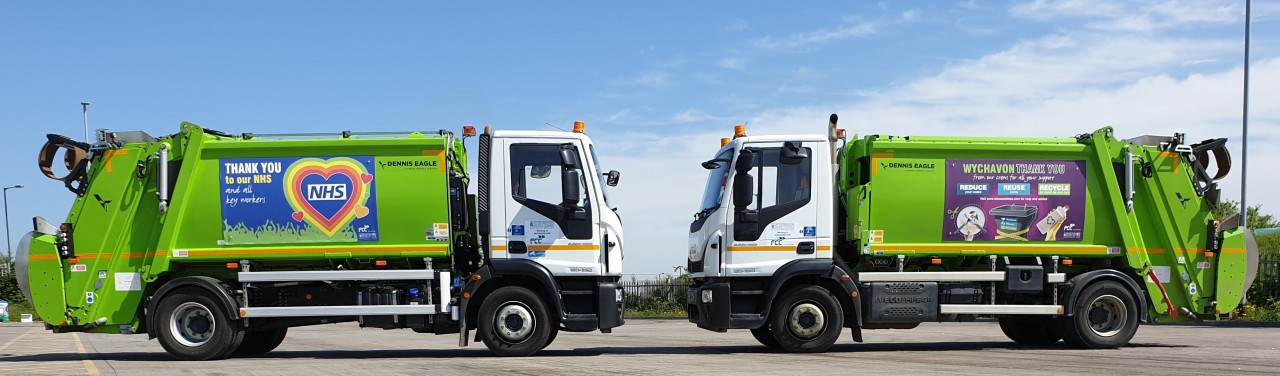 A photo of the bin lorries side by side with the new posters saying thank you to NHS staff.